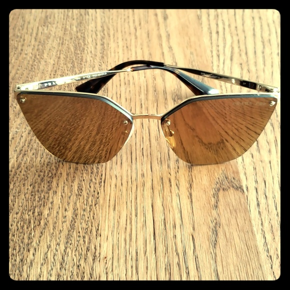 8c20b741c2d Prada Reflective Cateye Gold Sunglasses. M 5c5485389519966f97f57d39. Other  Accessories ...